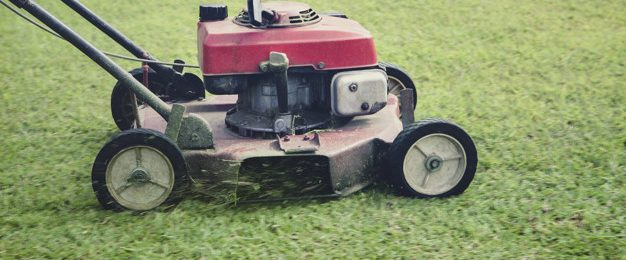 mowing moving on green grass field